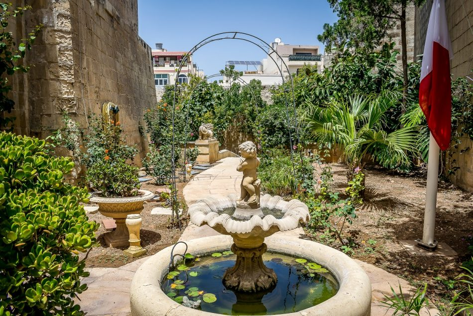The evergreen courtyard with a water fountain of Palazzo Stagno in the traditional village of Qormi. A perfect location for a private event or an outside catering function by Xara Catering