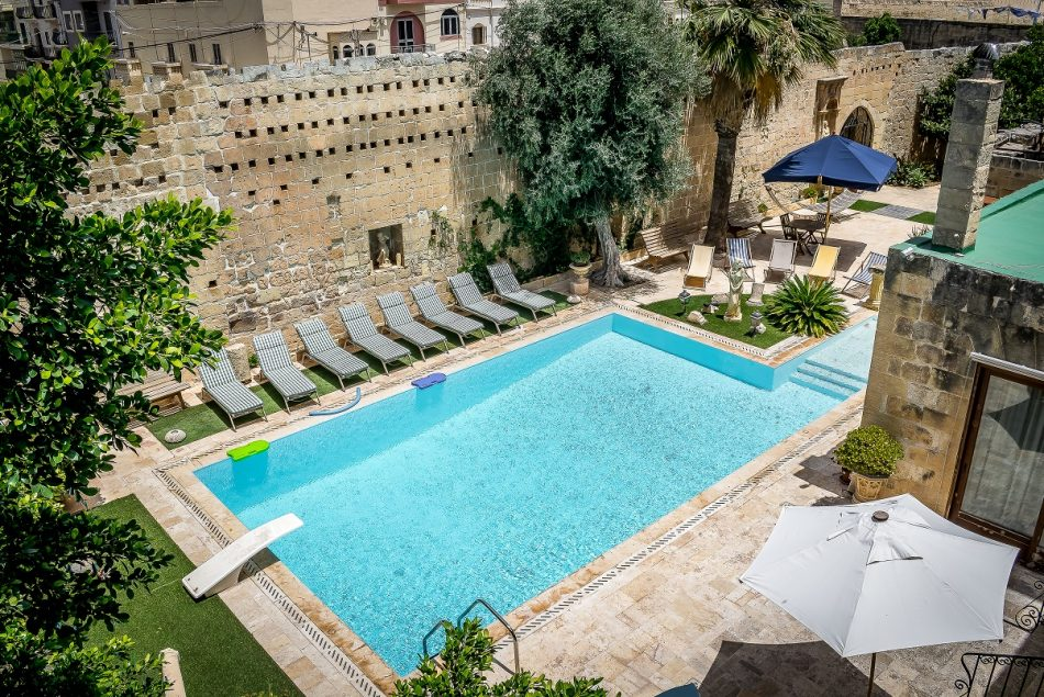 A luscious swimming pool in the green courtyard of Palazzo Stagno ideal for outside catering events or private functions hosted by Xara Catering